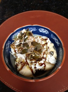 Ice Cream with whipped cream Pumpkin Seed oil and nuts and seeds