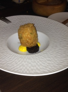 Haddock with poached egg and black pudding