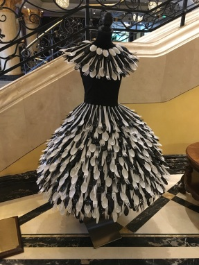 A Dress made out of plastic spoons